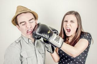 Girl-punching-boy-with-boxing-glove